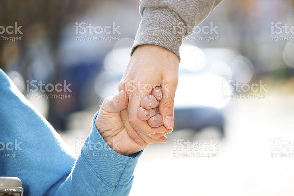 Caregiver Holding Senior's Hand royalty-free stock photo