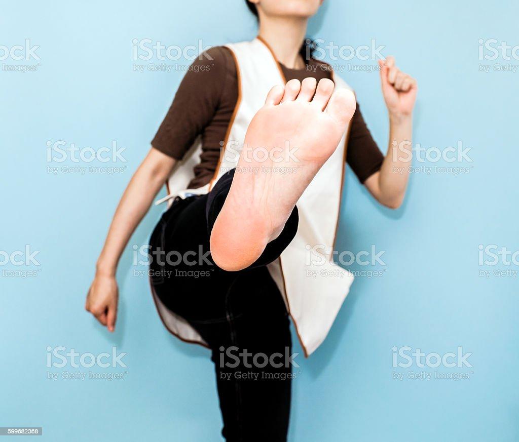 Caregiver kicking stock photo