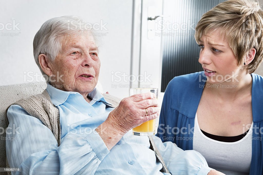 caregiver listening to senior woman royalty-free stock photo