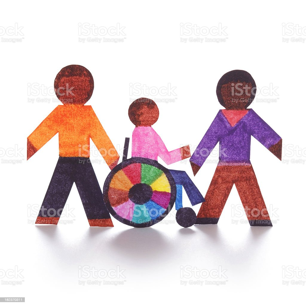 Caregivers with wheelchair-bound person - paper concept royalty-free stock photo
