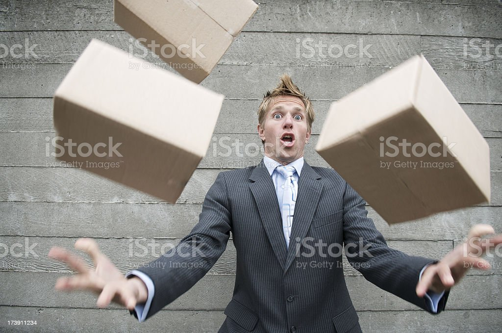 Careless Man Dropping Delivery of Brown Boxes Outdoors stock photo