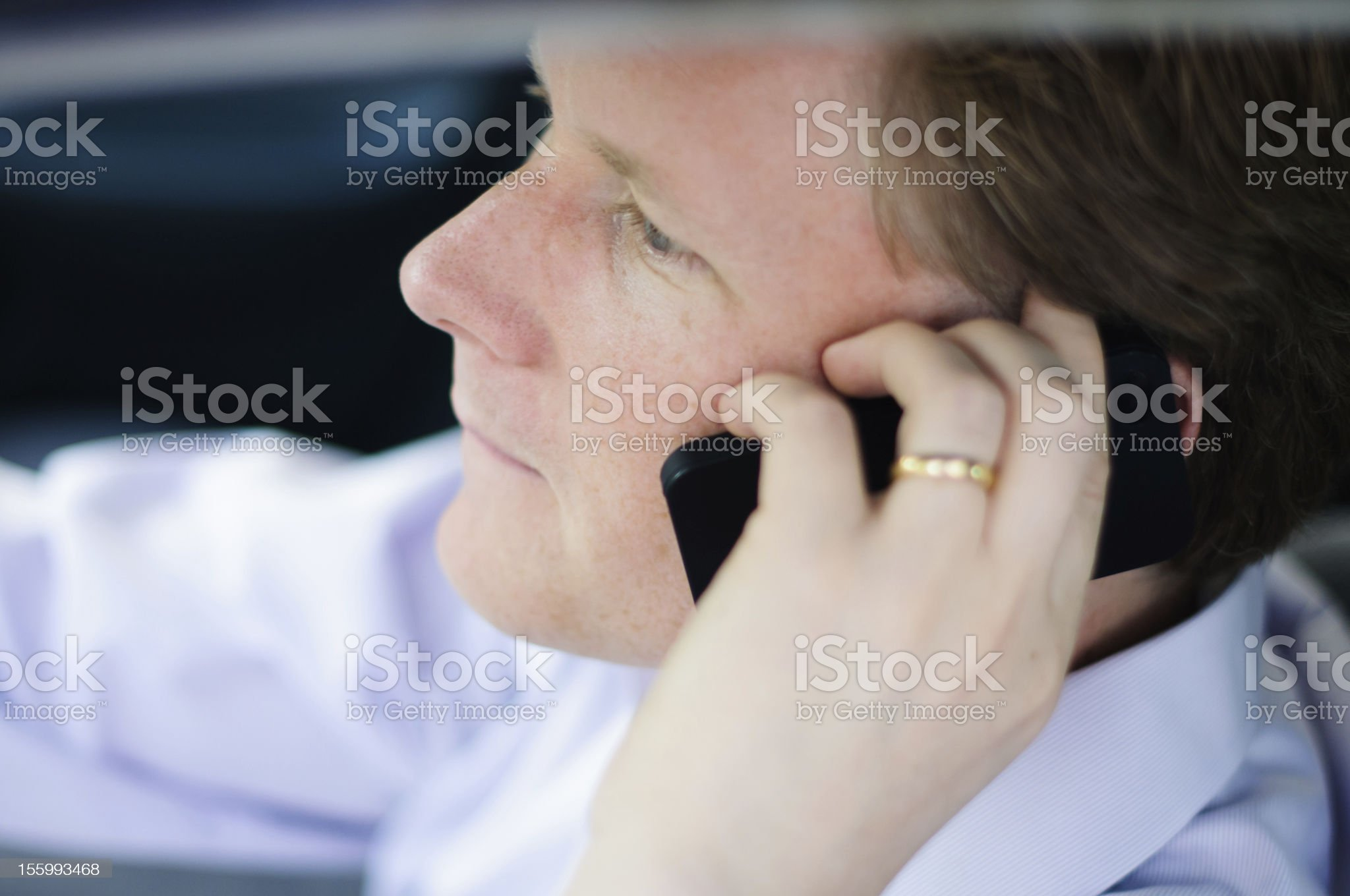 Careless man recklessly driving and talking on cell phone royalty-free stock photo