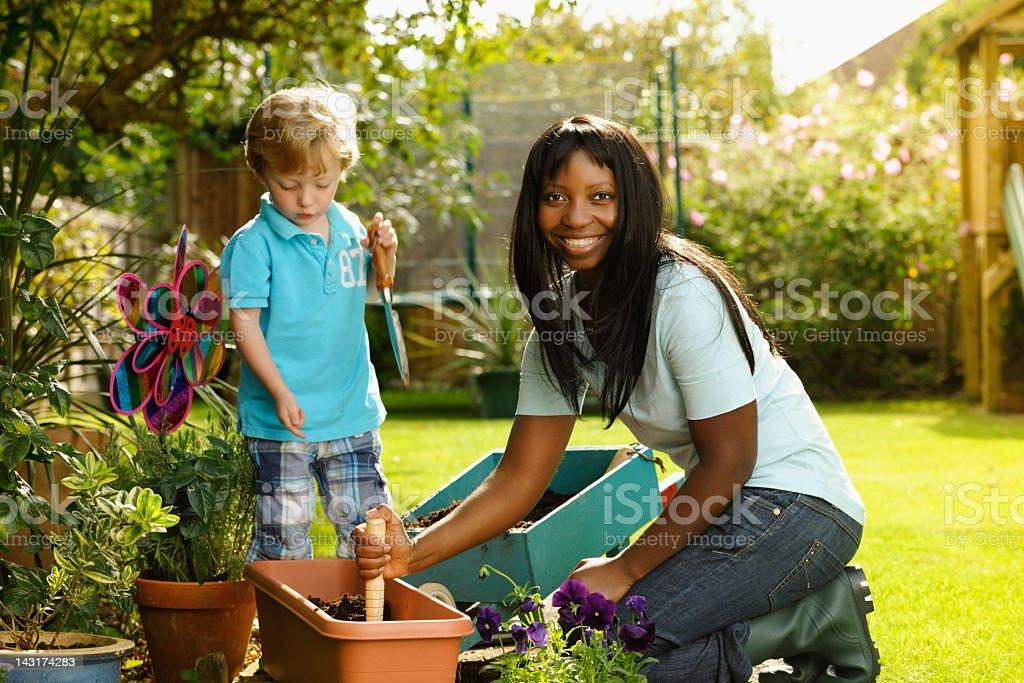 Carer/ Childminder Gardening With Little Boy royalty-free stock photo