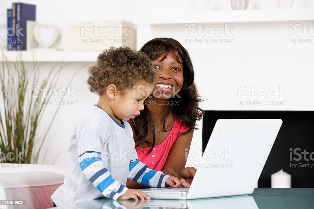 Carer/ Mother Pleased With Toddler's Progress stock photo