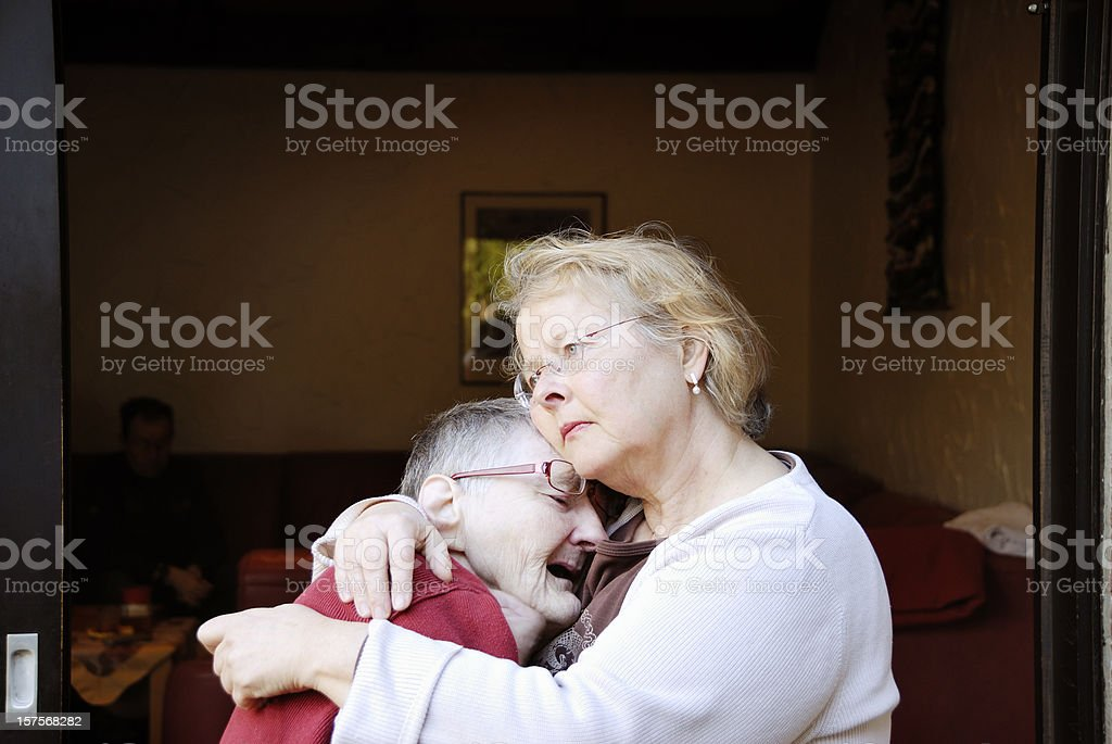 caretaker consoling crying senior woman royalty-free stock photo
