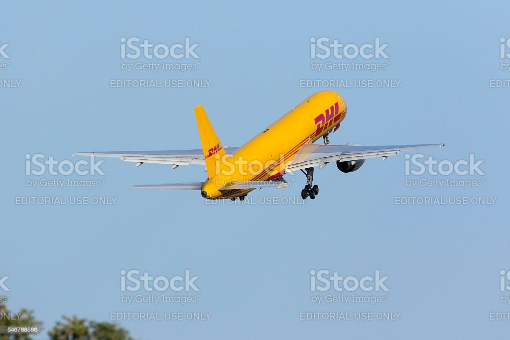 Cargo 757 climbing out of the runway stock photo