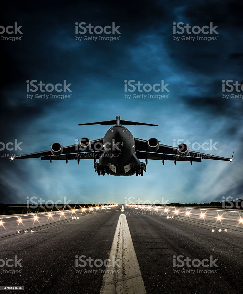 Cargo Airplane landing at dusk stock photo