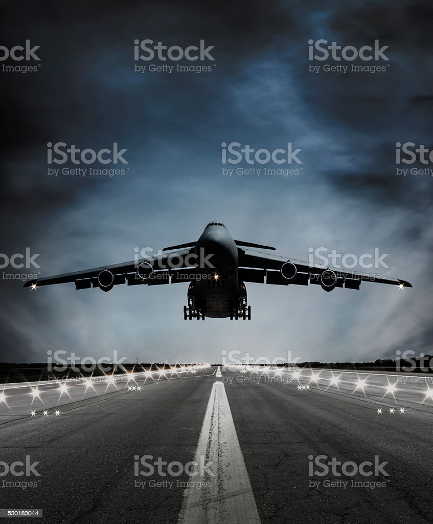 Cargo Airplane landing at dusk stock photo