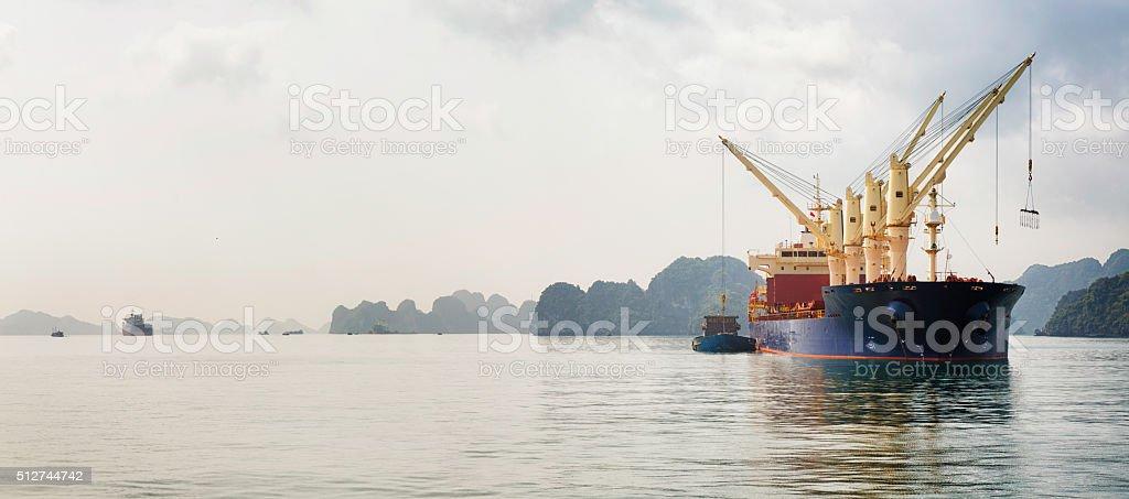 Cargo boat in Halong Bay panorama stock photo