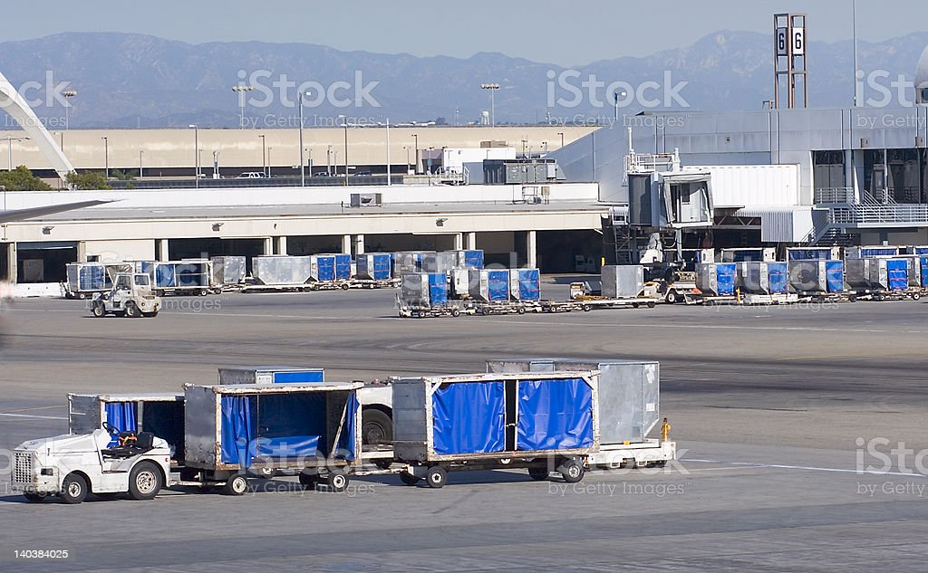 Cargo carts in airport stock photo
