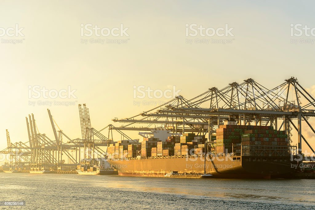 Cargo container ship at a container terminal in Rotterdam port stock photo