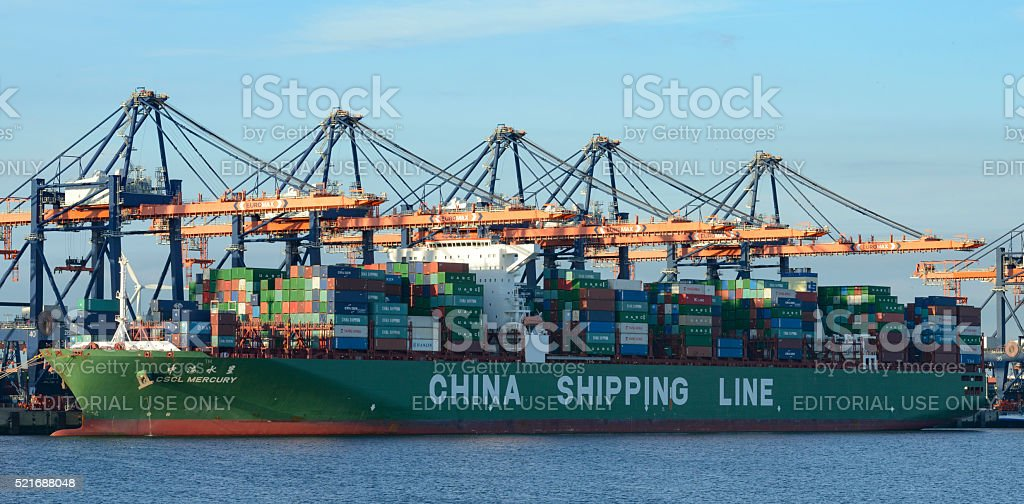 Cargo container ship at the container terminal stock photo