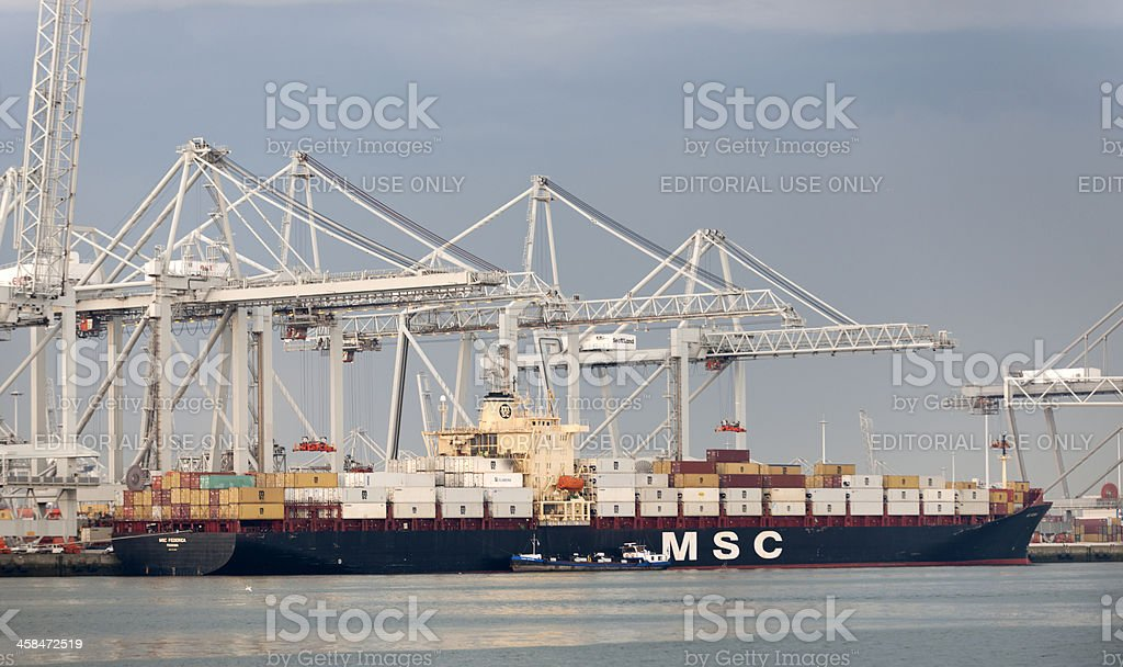 cargo container ship in harbor stock photo