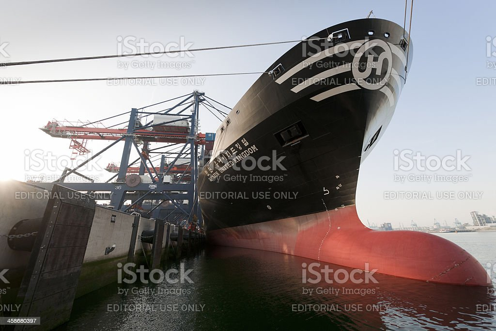 cargo container ship loading in harbor stock photo