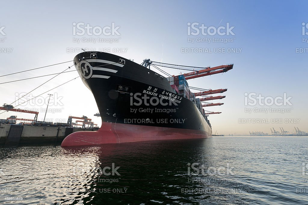 cargo container ship loading in harbour stock photo
