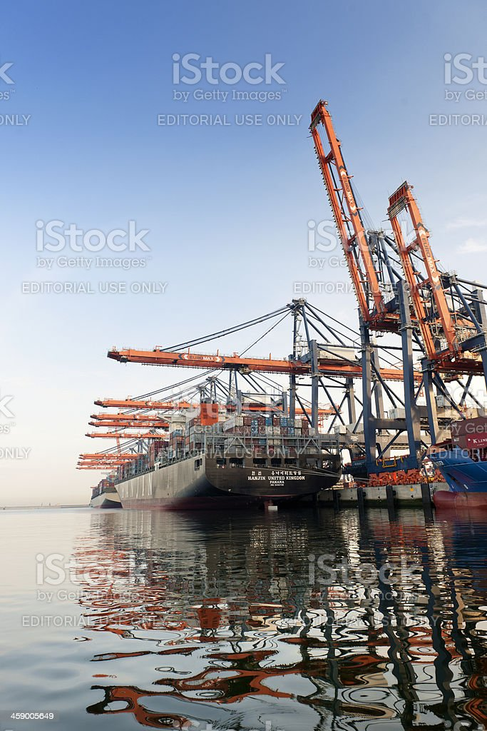cargo container ship moored in harbour stock photo