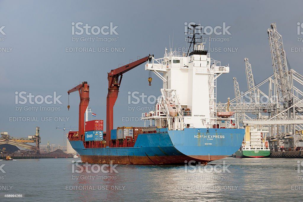 cargo container ship sailing in commercial dock stock photo
