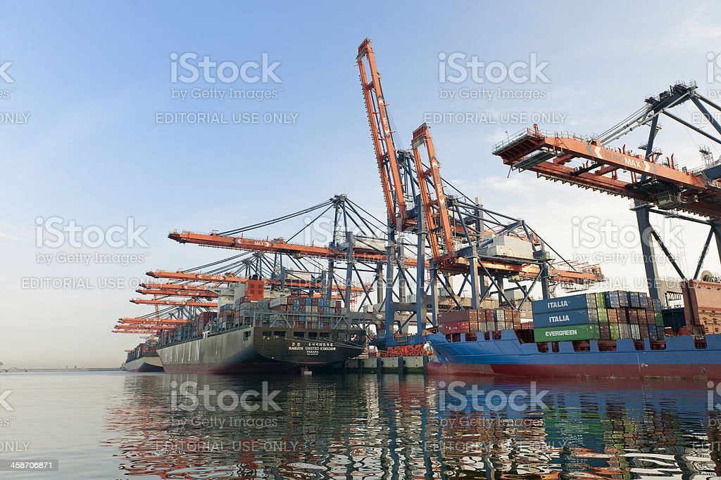 cargo container ships loading in harbour stock photo
