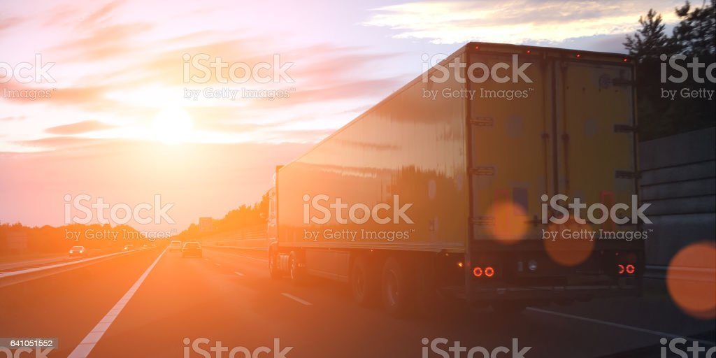 Cargo container truck highway road rural countryside sunset stock photo