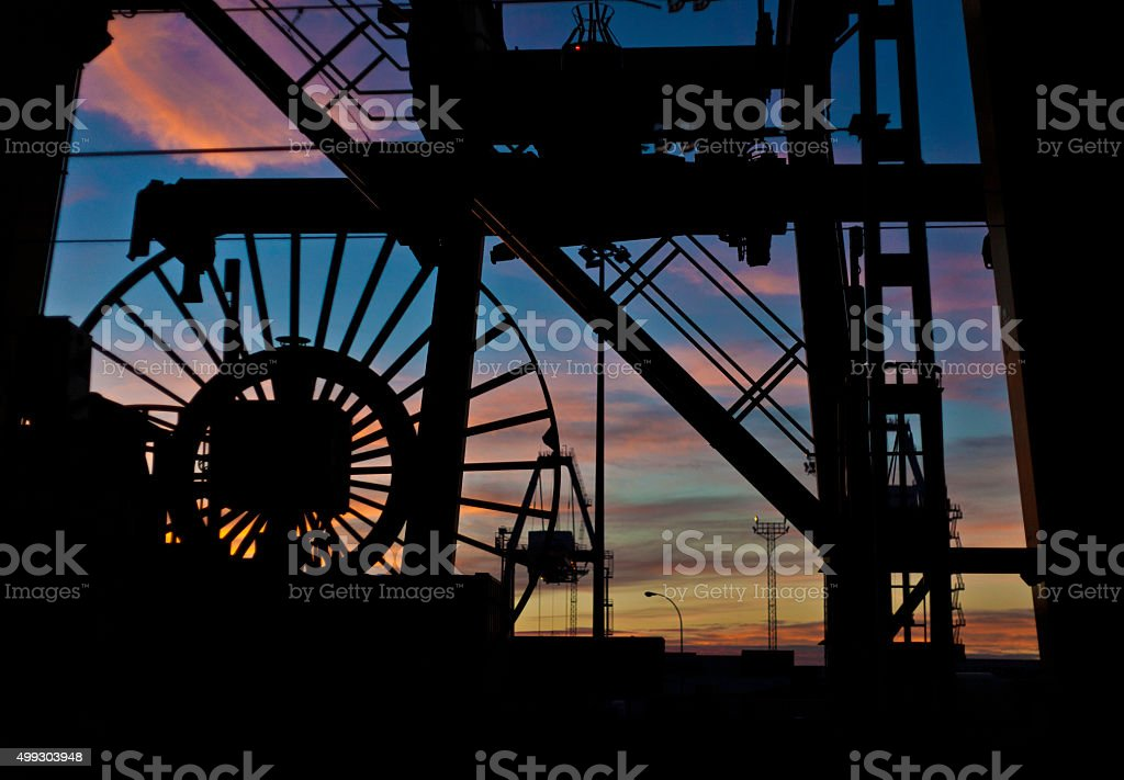 Cargo containers and crane at harbor stock photo