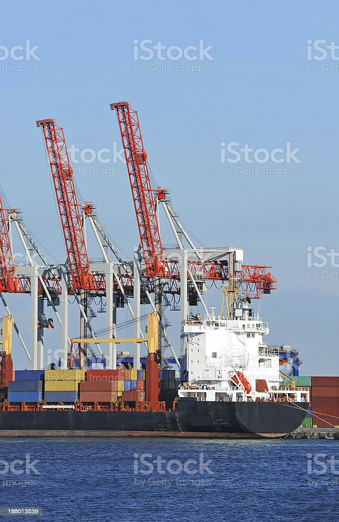 Cargo crane and container ship royalty-free stock photo