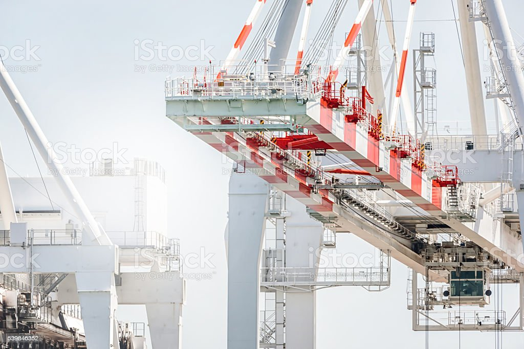 Cargo crane of the container terminal in port. stock photo