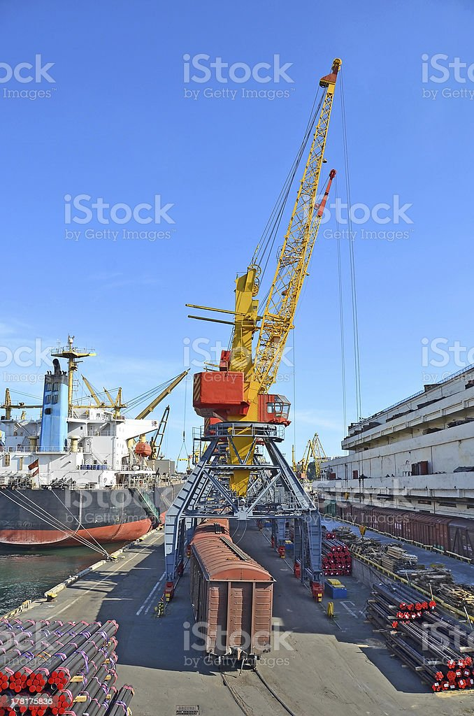 Cargo crane, pipe, train and ship royalty-free stock photo
