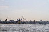 Cargo crane ship and grain dryer in port Odessa