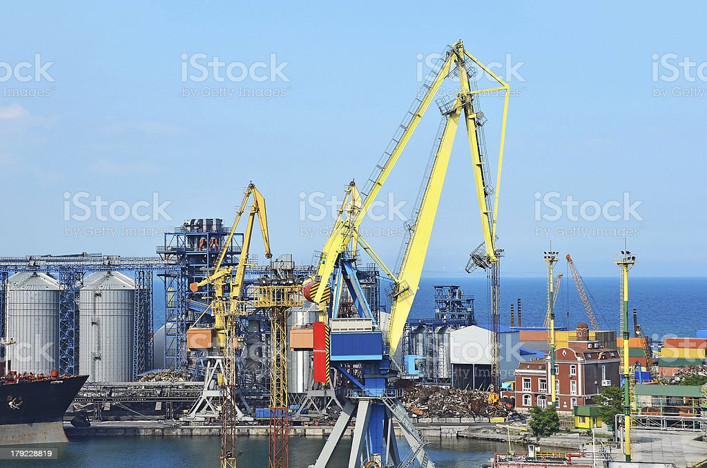 Cargo crane, ship and grain dryer royalty-free stock photo