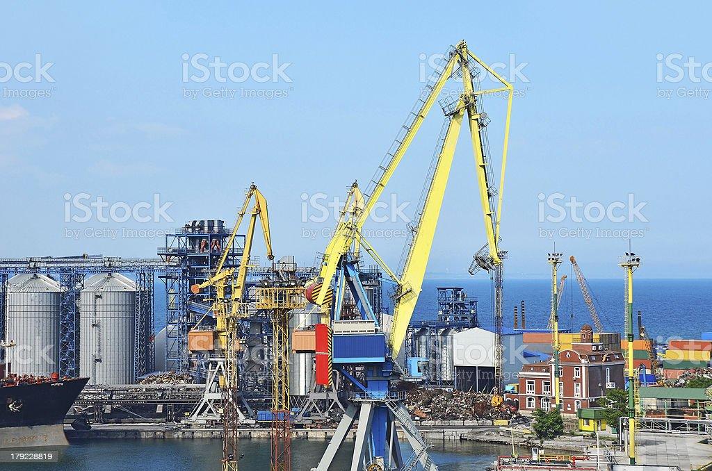 Cargo crane, ship and grain dryer royalty-free stock photo