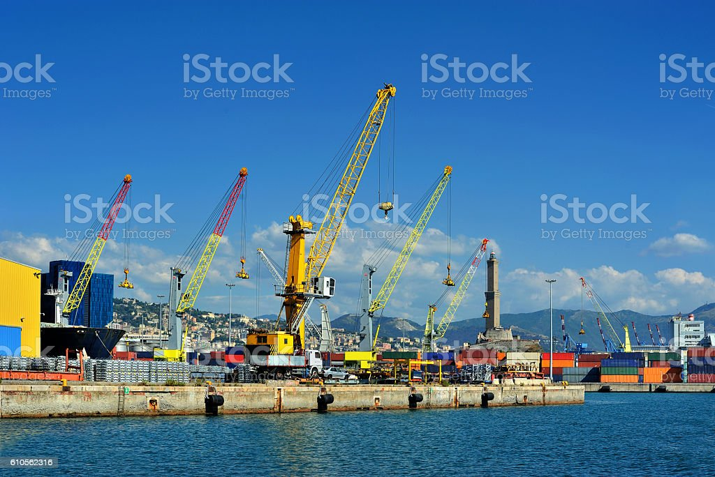 Cargo cranes with warehouse in Genova sea industrial port stock photo