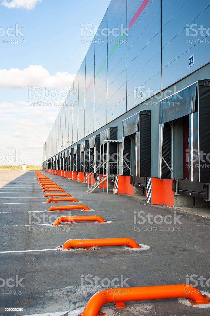 Cargo doors at big industrial warehouse building stock photo