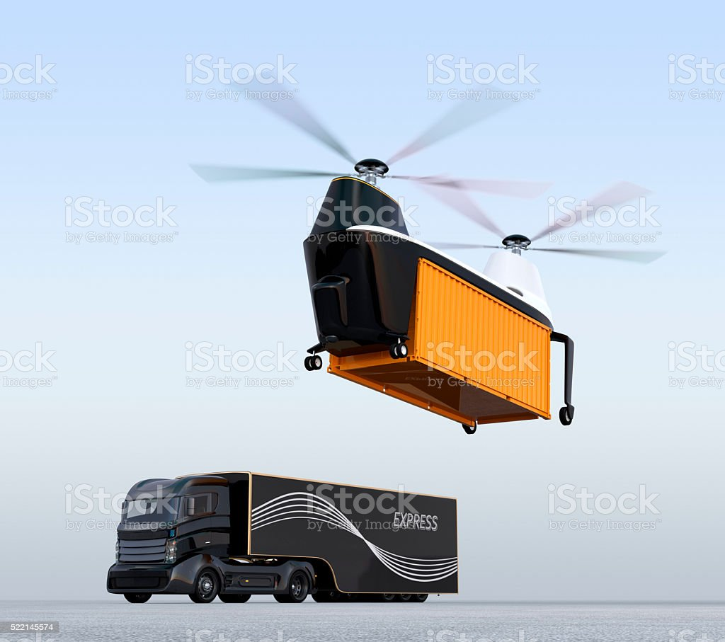 Cargo drone prepare to landing beside a hybrid truck stock photo
