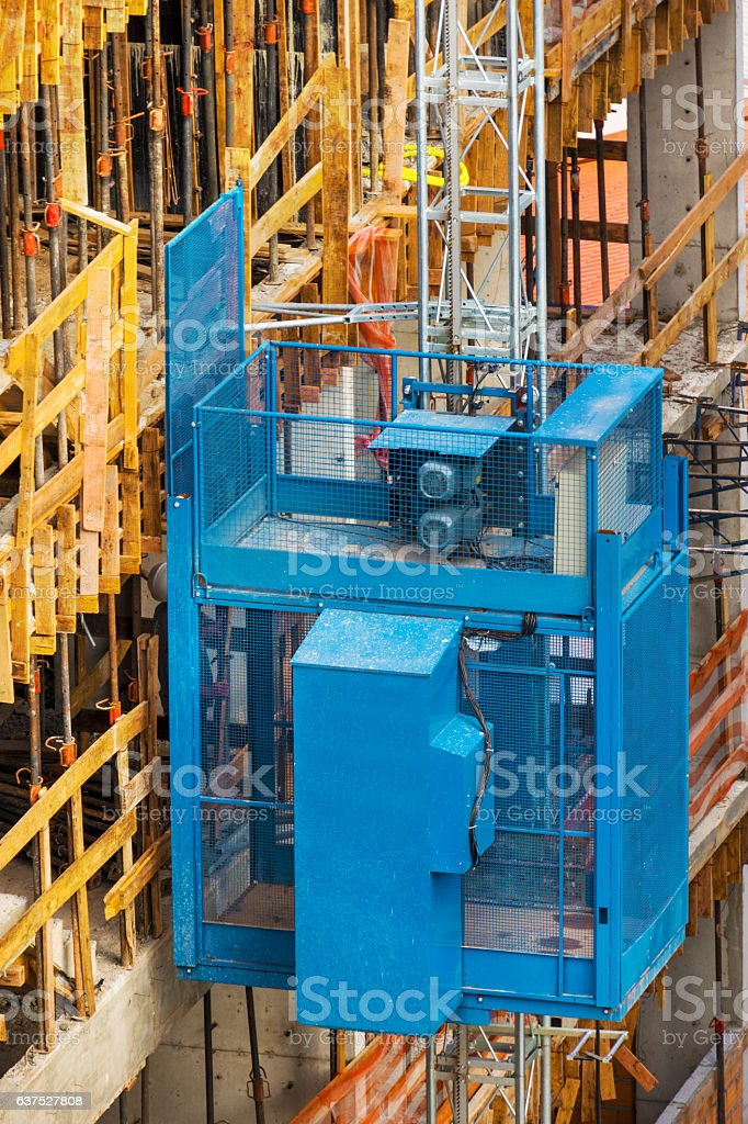 Cargo elevator in a construction stock photo
