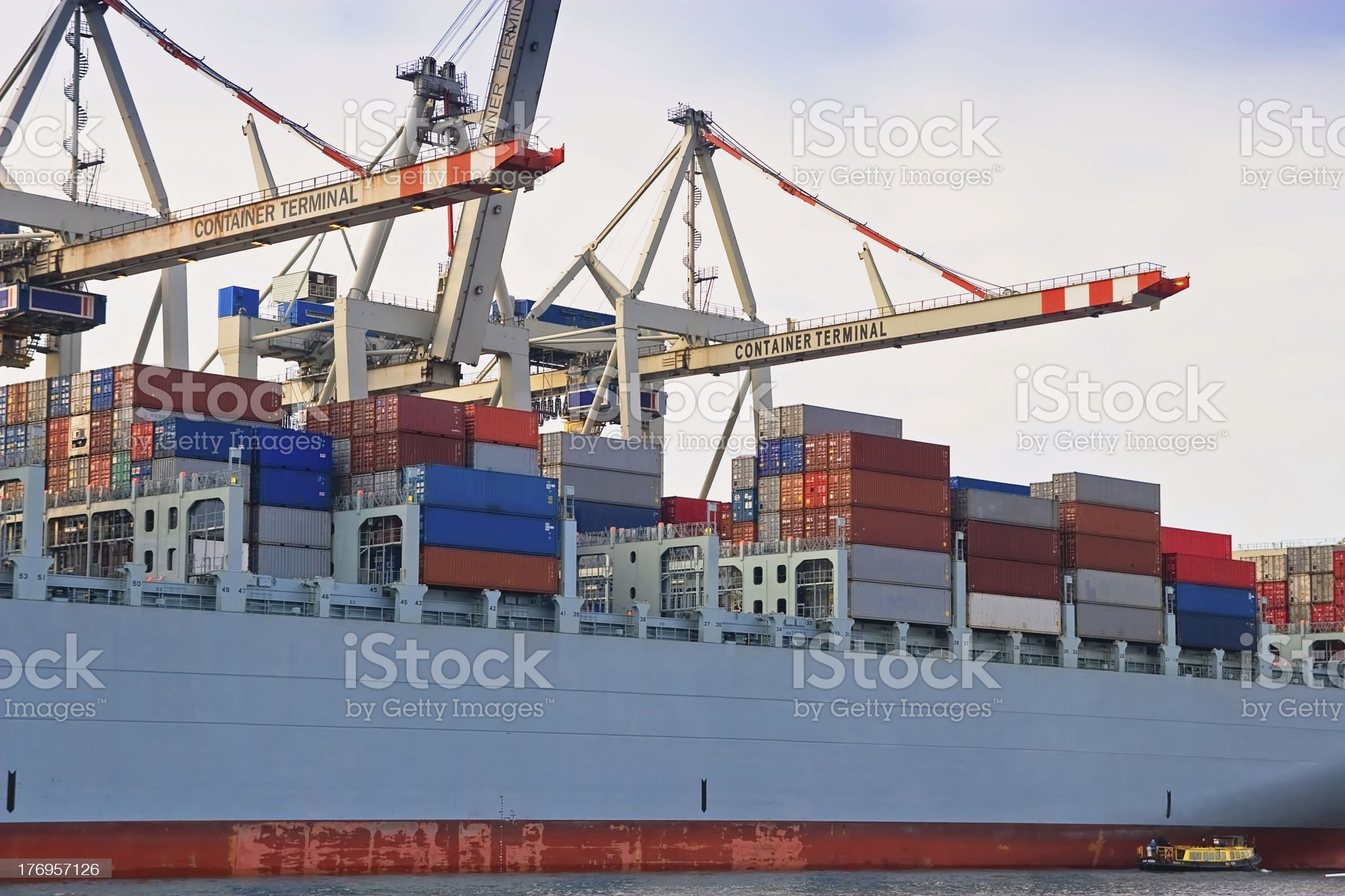 Cargo freight container ship at harbour terminal royalty-free stock photo
