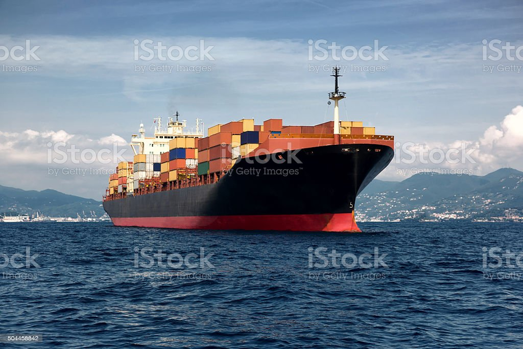 cargo freight, container ship in sea stock photo