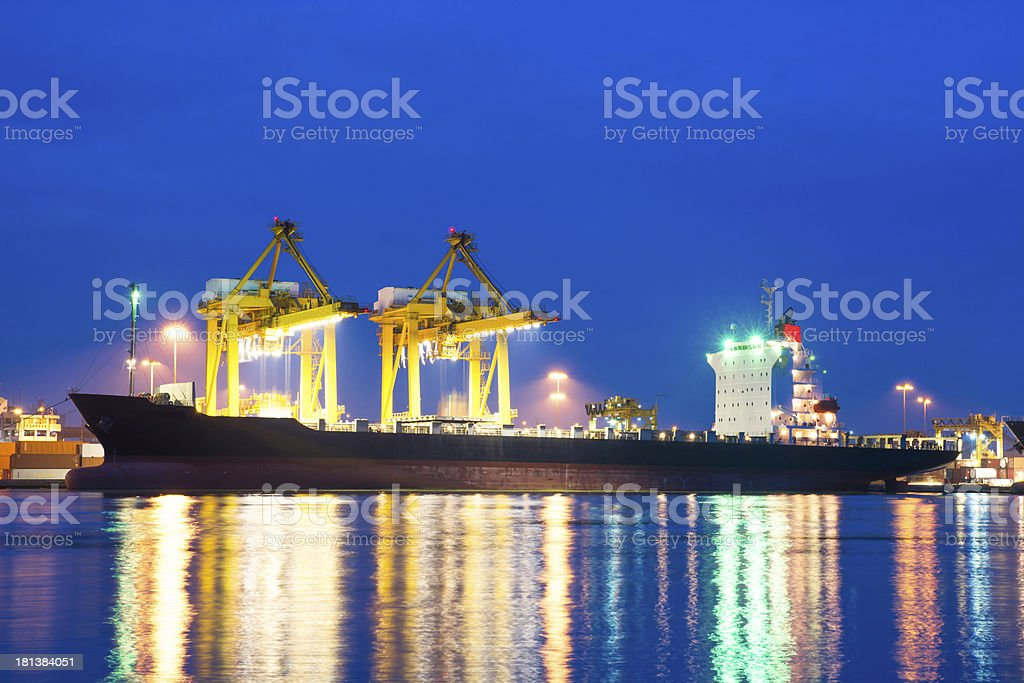 Cargo freight ship and crane during working at the Quayside royalty-free stock photo