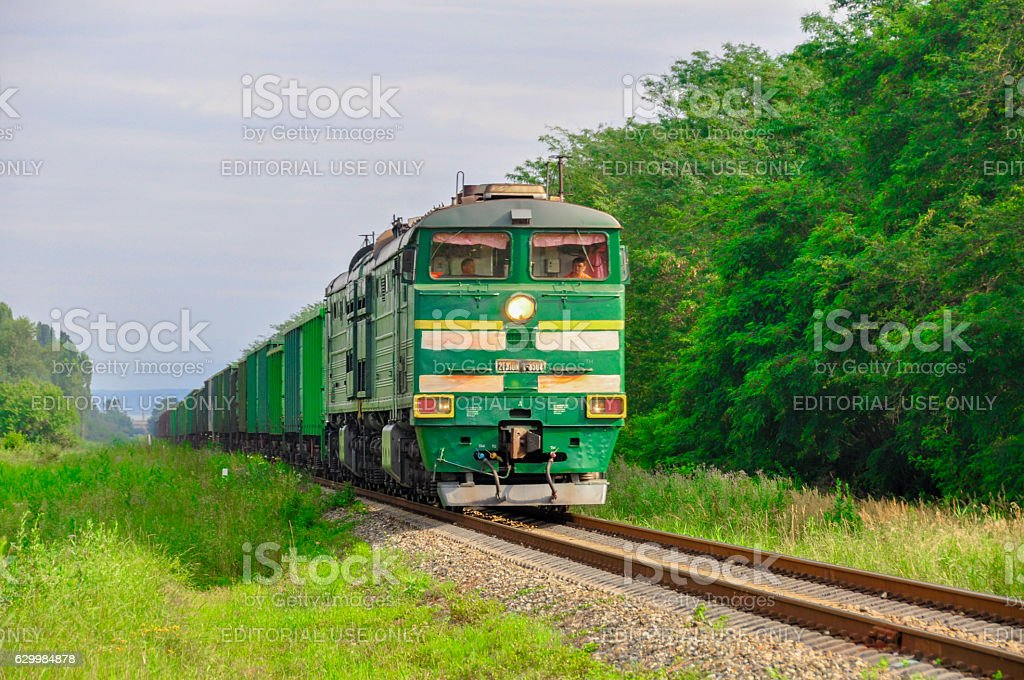 Cargo freight train among the green nature stock photo