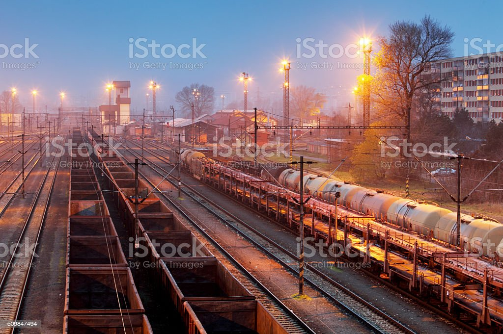 Cargo freigt train railroad station at dusk stock photo