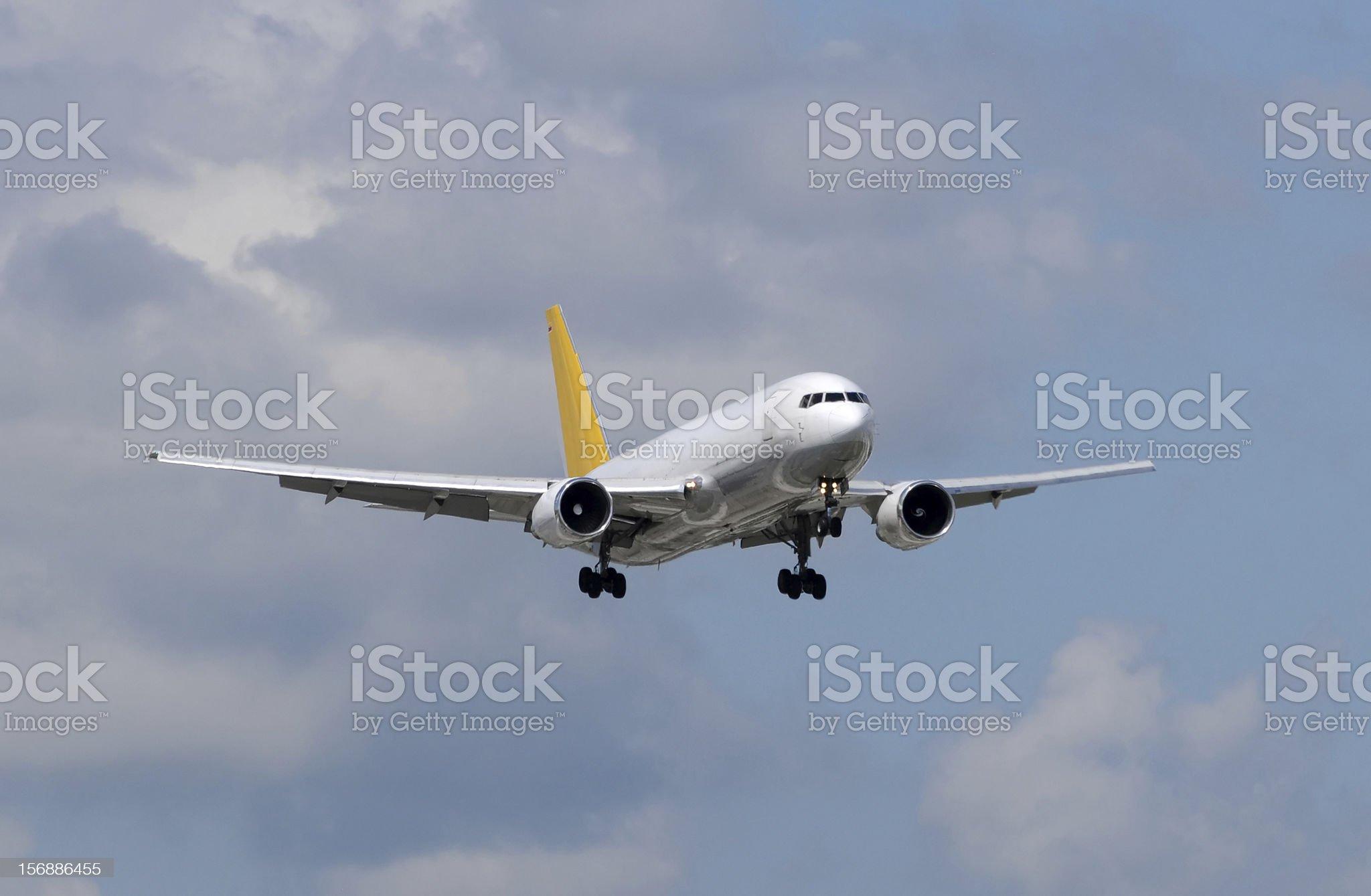 Cargo jet landing royalty-free stock photo