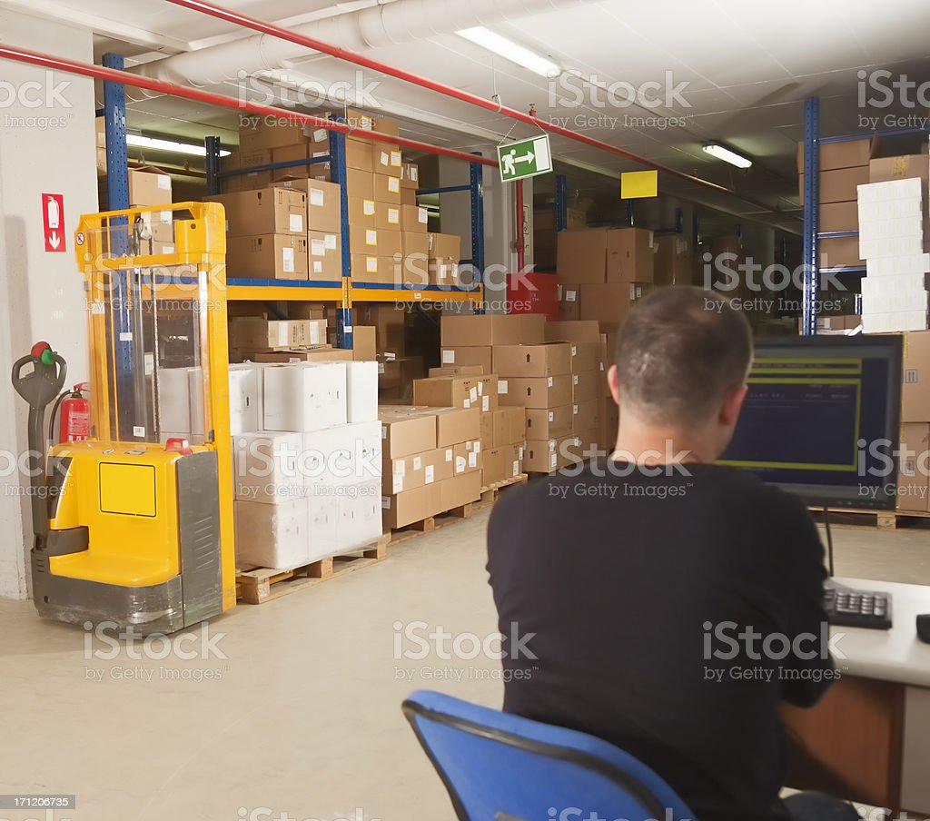 Cargo man checking on computer royalty-free stock photo