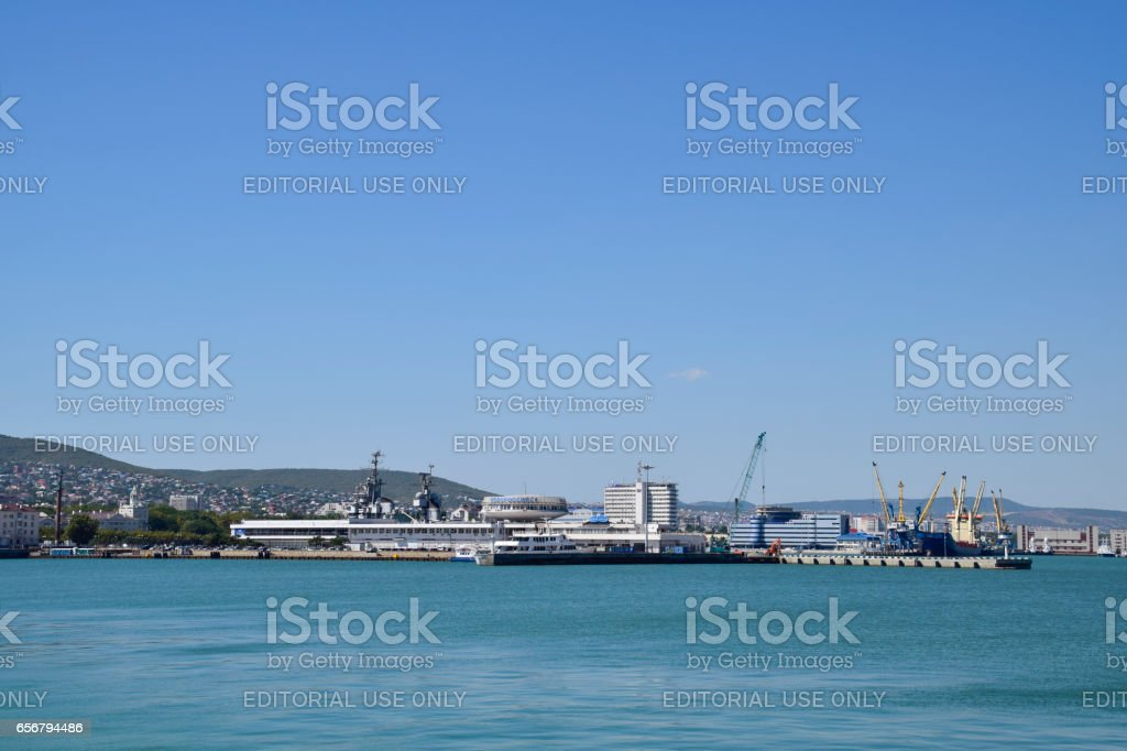 Cargo port with port cranes. Sea bay and mountainous coast. stock photo