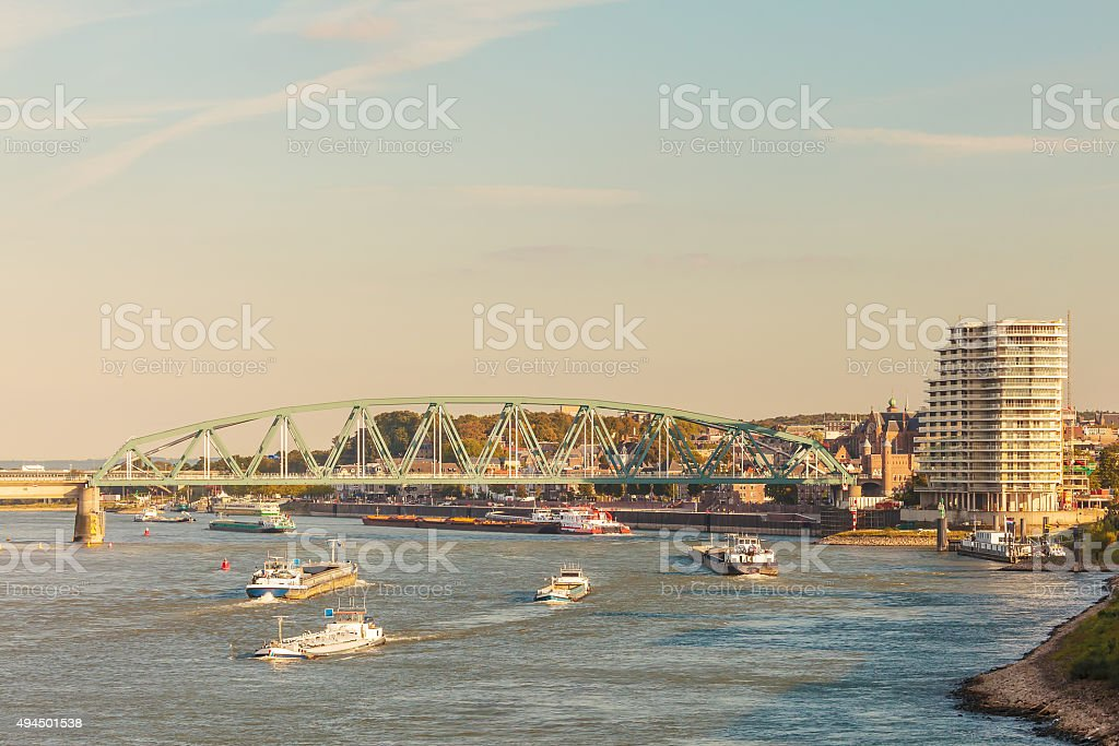 Cargo riverboats passing the Dutch city of Nijmegen stock photo