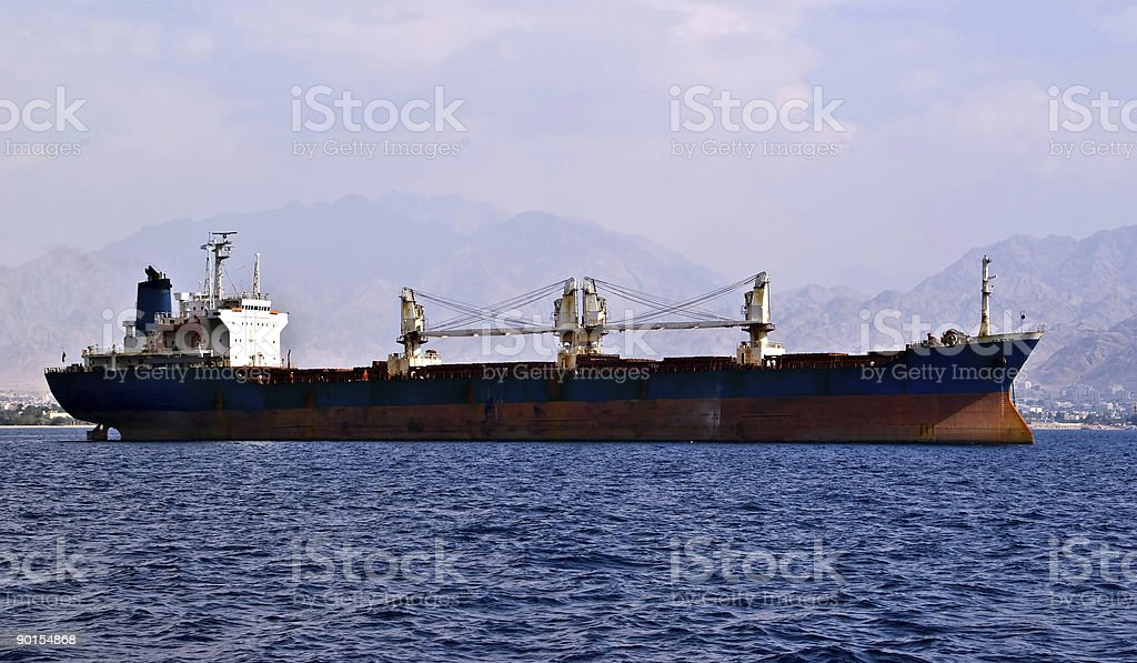 Cargo ship anchored in a harbore royalty-free stock photo
