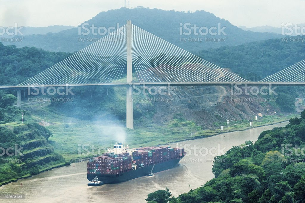 Cargo ship and Centerary Bridge on Panama Canal stock photo