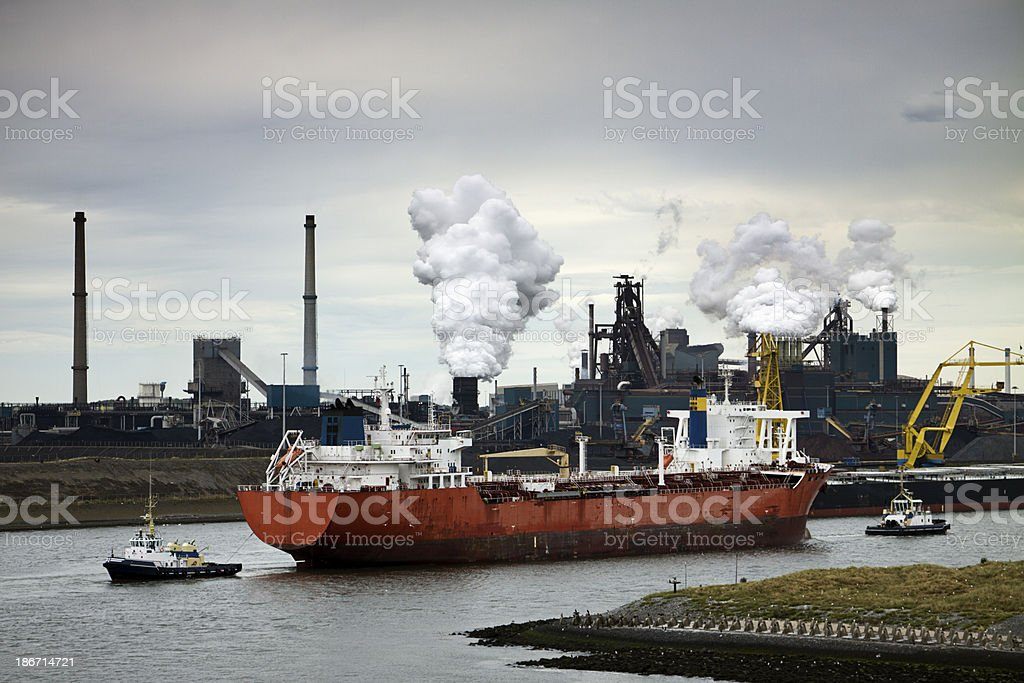 Cargo ship and heavy industry in Holland. royalty-free stock photo