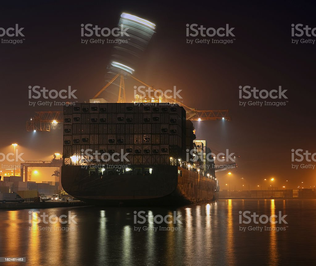 Cargo ship and port cranes royalty-free stock photo