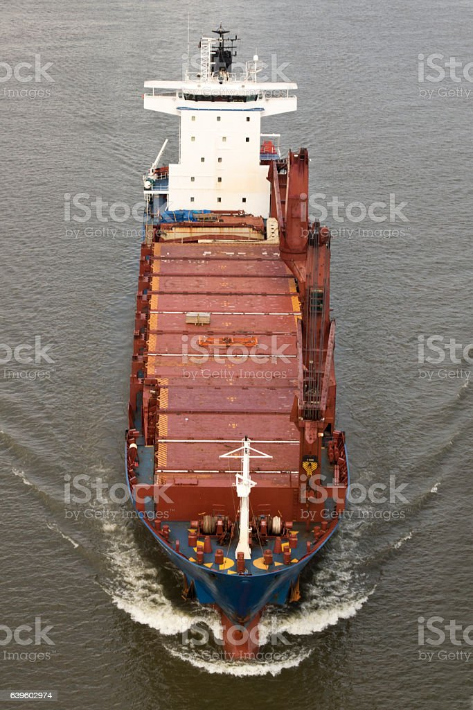 Cargo ship approaching, Arial view, sailing underway stock photo
