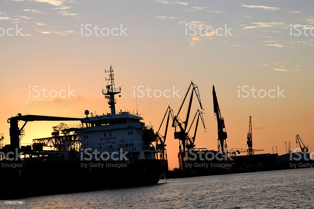 cargo ship at shipyard late afternoon stock photo
