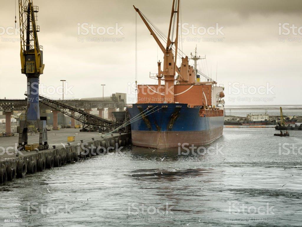 Cargo ship docked at at the port of Walvis Bay, Namibia stock photo